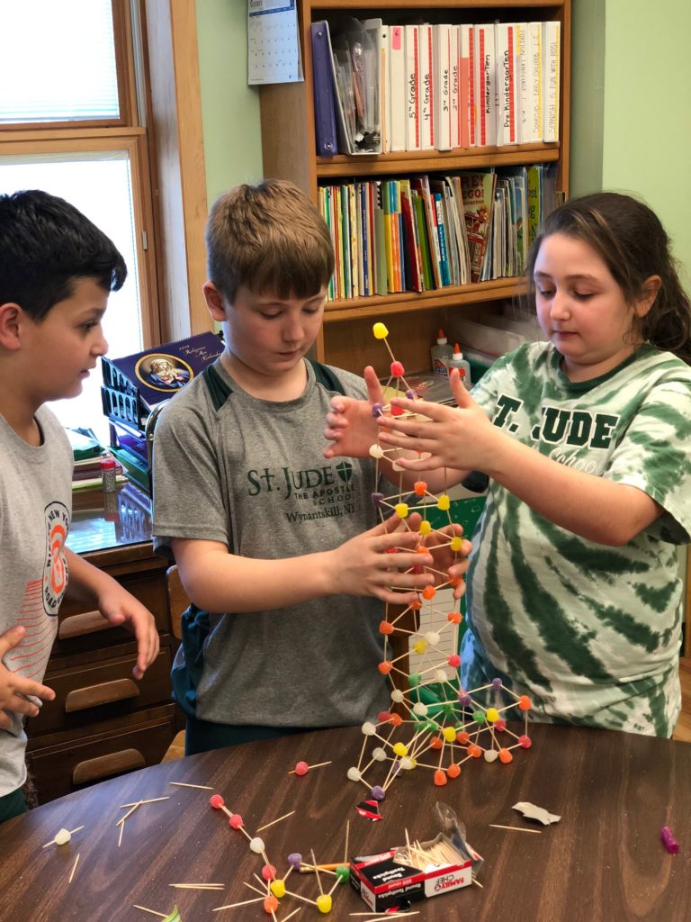 Fourth grader collaboration on building a gumdrop tower