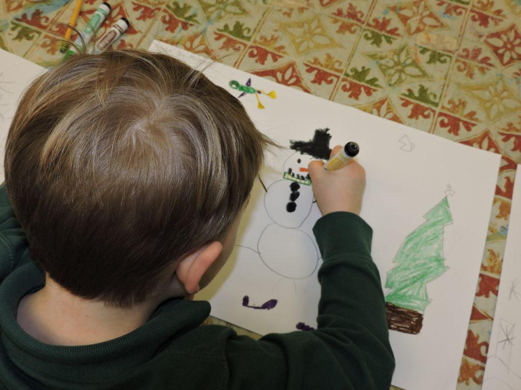 Student working on winter scene.