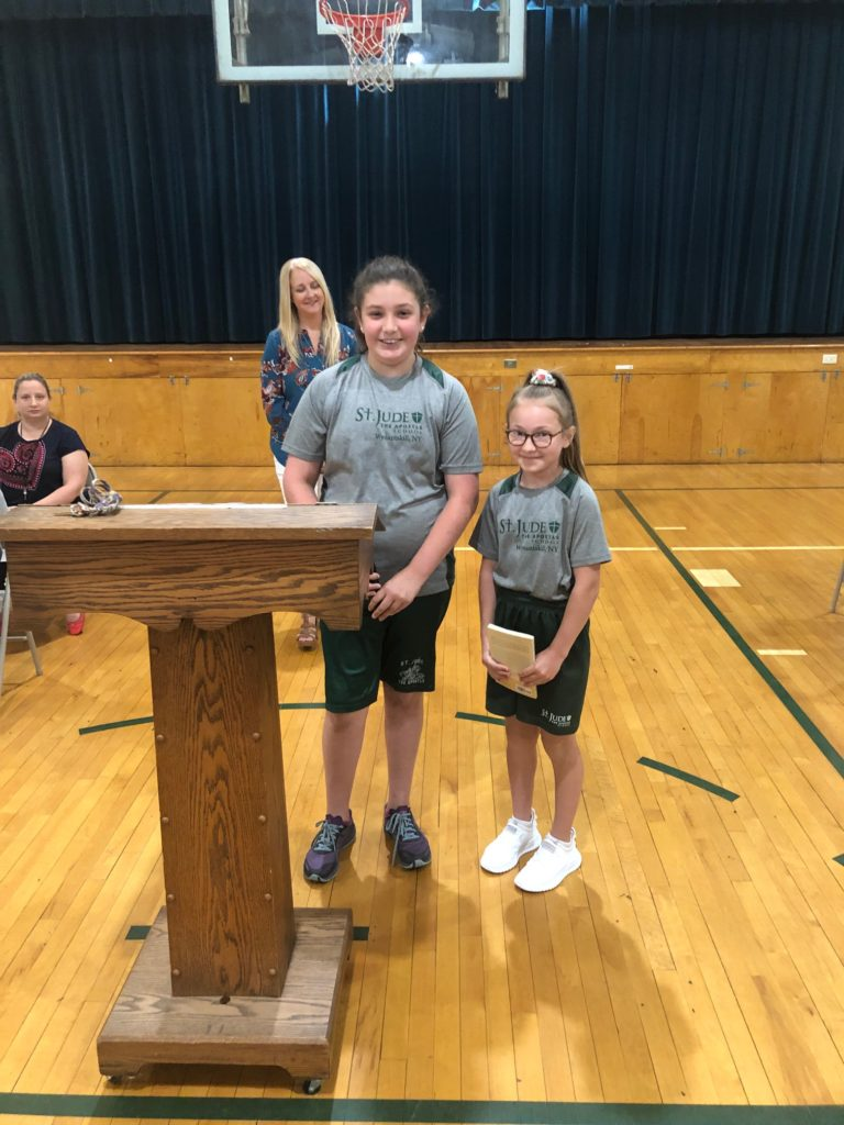 """Sixth Graders in """"Pass it down"""" ceremony at St. Jude the Apostle School"""
